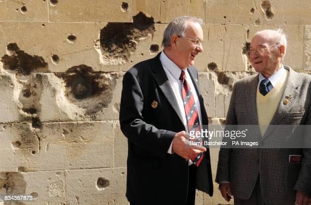 Luftwaffe pilot Willi Schludecker talks with Bath blitz service organiser Chris Kilminster in front of the bomb damaged former Labour Exchange in Bath