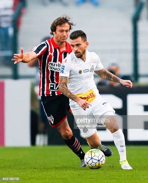 Lugano of Sao Paulo and Lucas Lima of Santos in action during the match between Santos and Sao Paulo for the Brazilian Series A 2016 at Pacaembu...
