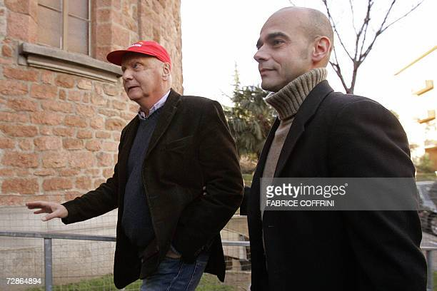 Former Formula One world motor racing champion Niki Lauda is accompagnied by Clay Regazzoni's sun Gian Maria while arriving 21 December 2006 for Clay...