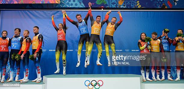 Luge Team Relay winners Silver Medallist Russia Gold Medallist Germany and Bronze Medallist Latvia celebrate at the Luge Team Relay Flower Ceremony...