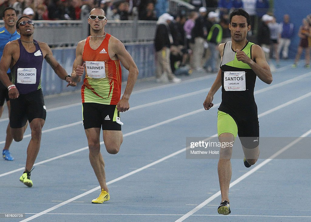 Lugelin Santos, of Puma, edges out Jeremy Wariner, of Adidas, in the Men's 400 Meter London Games Rematch at the Drake Relays, on April 26, 2013 at Drake Stadium, in Des Moines, Iowa.