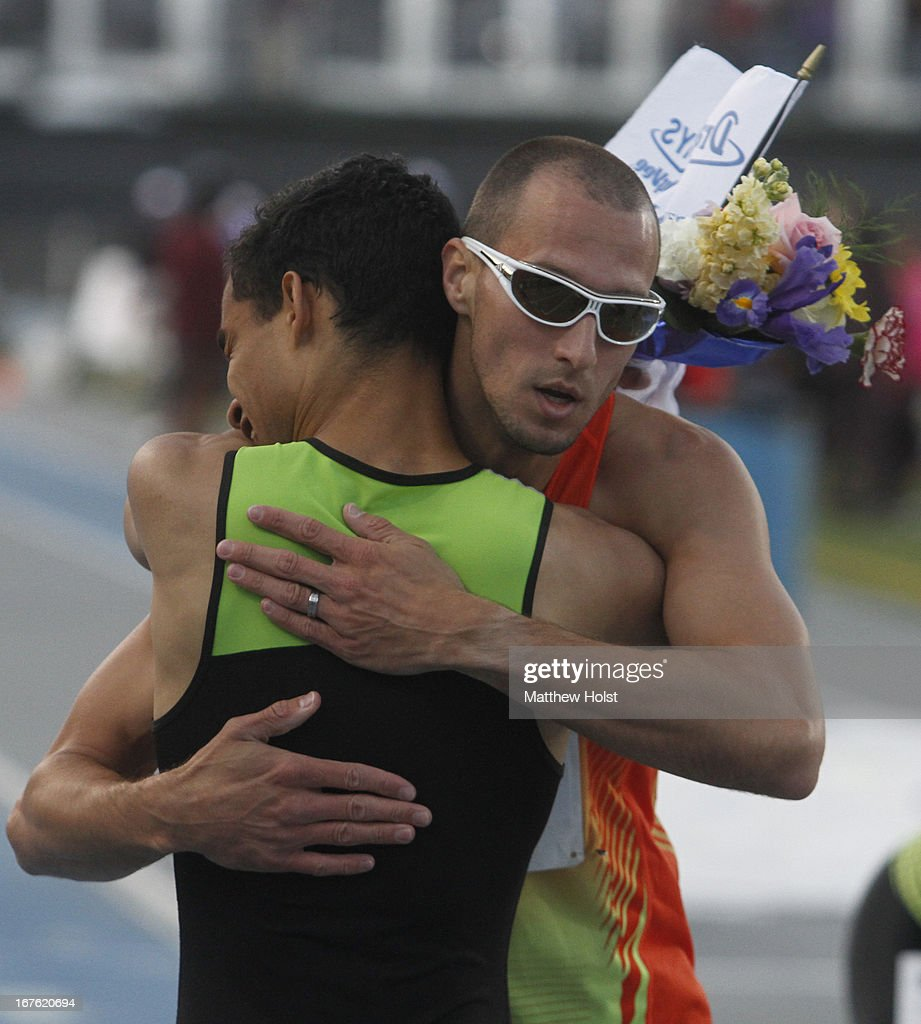 Lugelin Santos of Puma gets a hug from Jeremy Wariner of Adidas after the Men's 400 Meter London Games Rematch at the Drake Relays, on April 26, 2013 at Drake Stadium, in Des Moines, Iowa.