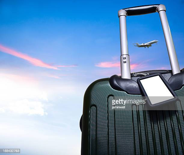 luggage and airplane on beautiful sky travel concept