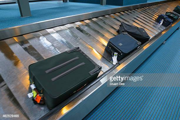 Luggage at carousel, airport
