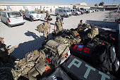 Luggage belonging to British troops is loaded onto a lorry to be taken to a aircraft at Kandahar airfield on November 11 2014 in Kandahar Afghanistan...