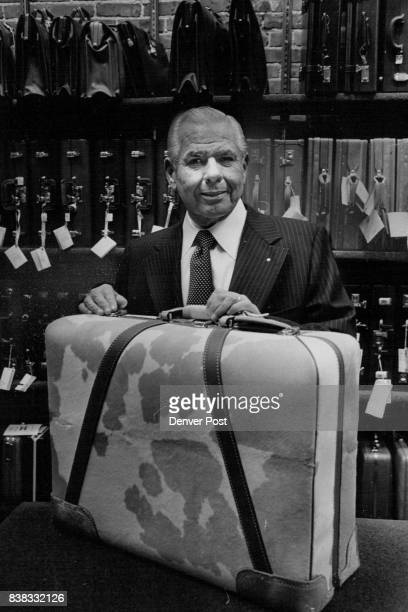 Luggage Firm Begins Its Rupert C Meek president of A E Meek Trunk and Bag Co displays one of his prize products at a celebration marking the pioneer...