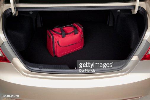 Luggage in Car Trunk