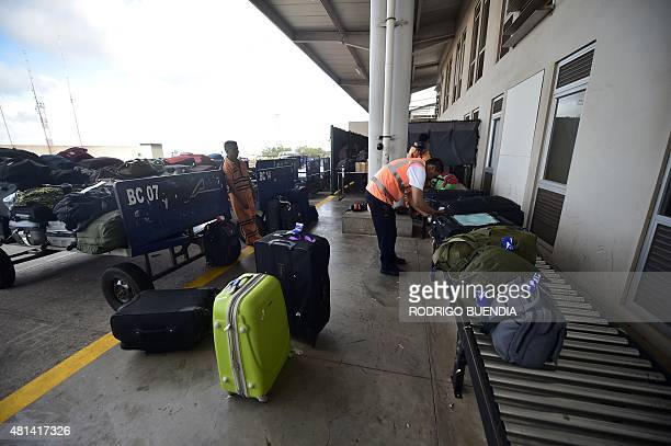 Luggage is inspected at the airport in Baltra one of the 13 islands that make up the Galapagos archipelago in the Pacific Ocean roughly 1000 km off...