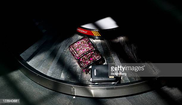 Luggage moves on a baggage carousel at Toronto Pearson International Airport in Toronto Ontario Canada on Tuesday Aug 30 2011 Toronto Pearson...