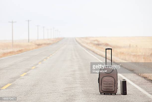 Luggage on a Rural Road