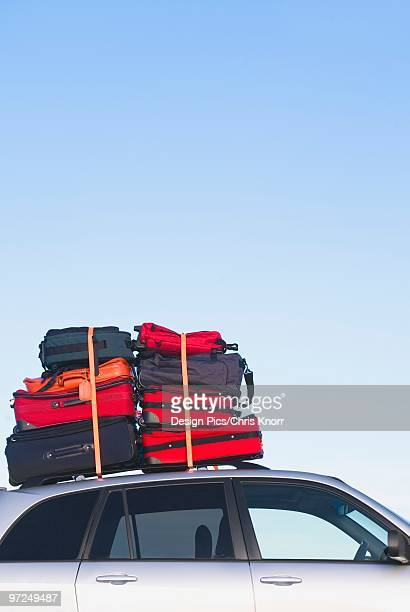 Luggage piled high on a car roof