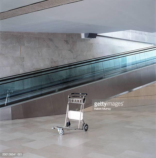 Luggage trolley by escalator