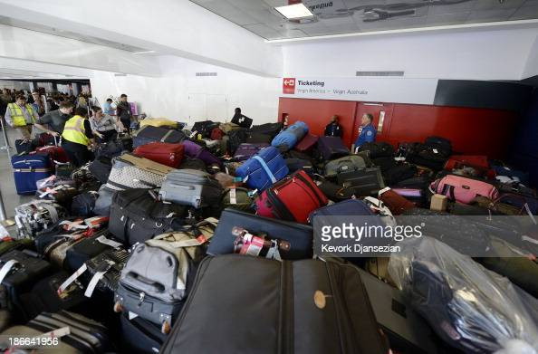 Luggage waits to get screened for departure in Terminal 3 a day after a shooting at Los Angeles International Airport November 2 2013 in Los Angeles...