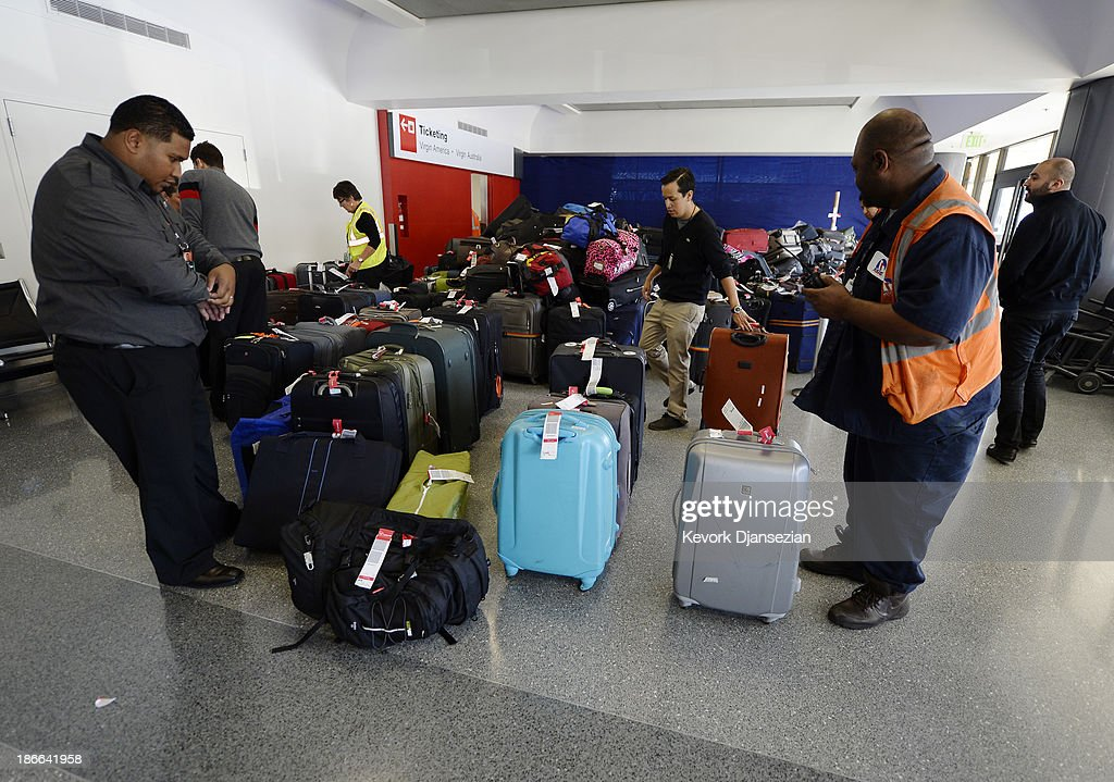 Luggage waits to get screened for departure in Terminal 3 a day after a shooting at Los Angeles International Airport November 2, 2013 in Los Angeles, California. The airport is almost back to normal operations a day after a man pulled an assault rifle and shot his way through security at Terminal 3, killing one Transportation Security Administration worker and wounding several others. Federal officials identified the alleged gunman as Paul Ciancia, 23, of New Jersey.