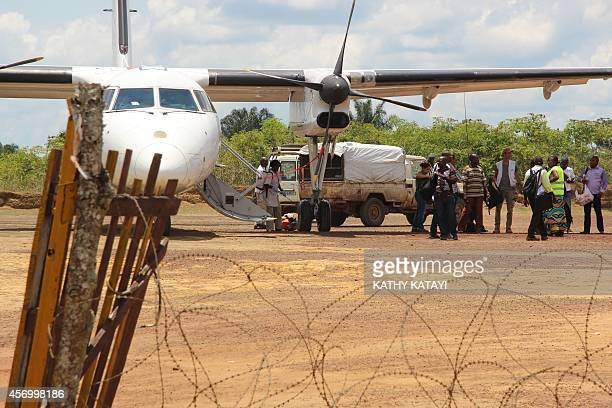 Luggages get disinfected after a plane's arrival at Boende's airport on October 8 as part of prophylactic measures against the spread of the Ebola...