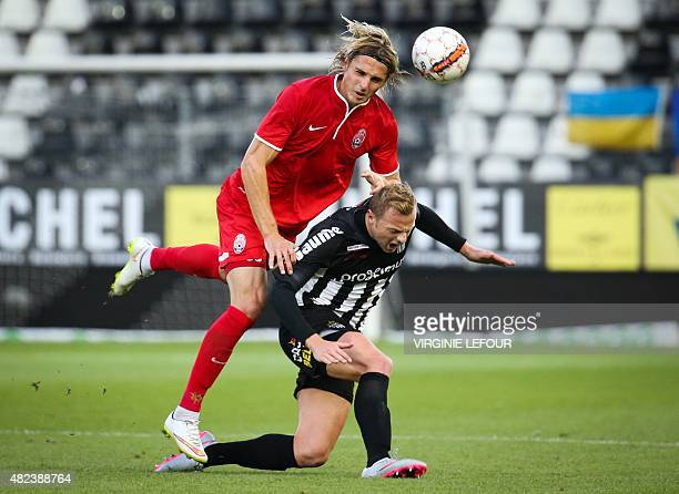 Luhansk's Andriy Pylyavskyi and Charleroi's David Pollet vie for the ball during the UEFA Europa League third qualifying round footbal match between...