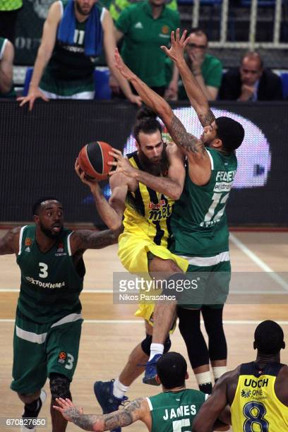 Luigi Datome #70 of Fenerbahce Istanbul competes with James Feldeine #12 of Panathinaikos Superfoods Athens during the 2016/2017 Turkish Airlines...