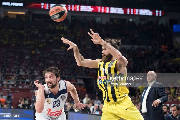 Luigi Datome #70 of Fenerbahce Istanbul competes with Sergio Llull #23 of Real Madrid during the Turkish Airlines EuroLeague Final Four Semifinal A...