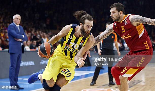 Luigi Datome #70 of Fenerbahce Istanbul competes with Vladimir Micov #5 of Galatasaray Odeabank Istanbul during the 2016/2017 Turkish Airlines...