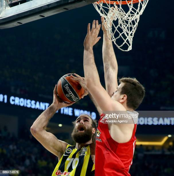 Luigi Datome of Fenerbahce in action against Nikola Milutinov of Olympiacos during the Turkish Airlines Euroleague Final Four basketball final match...