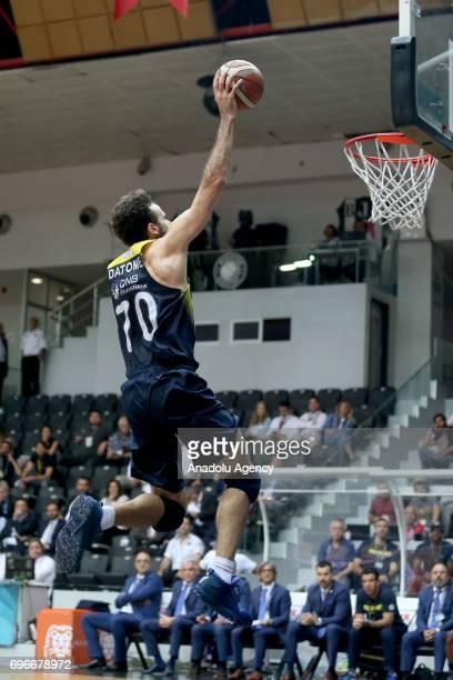 Luigi Datome of Fenerbahce slam dunks during Turkish Spor Toto Basketball League playoffs final's fourth leg match between Besiktas Sompo Japan and...