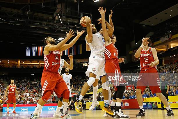 Luigi Datome of Italy drives to the basket against Turkey during the FIBA EuroBasket 2015 Group B basketball match between Italy and Turkey at Arena...