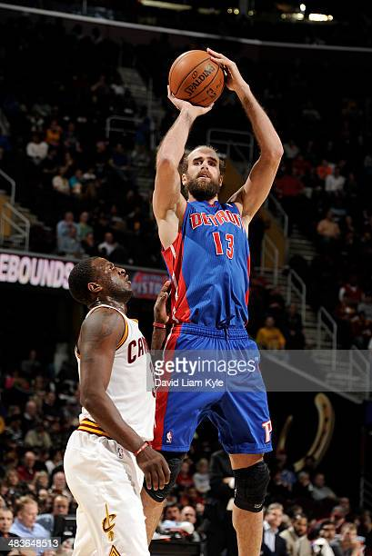 Luigi Datome of the Detroit Pistons shoots against Dion Waiters of the Cleveland Cavaliers at The Quicken Loans Arena on April 9 2014 in Cleveland...