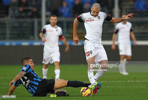 Luigi Giorgi of AC Cesena competes for the ball with Carlos Carmona of Atalanta BC during the Serie A match between Atalanta BC and AC Cesena at...
