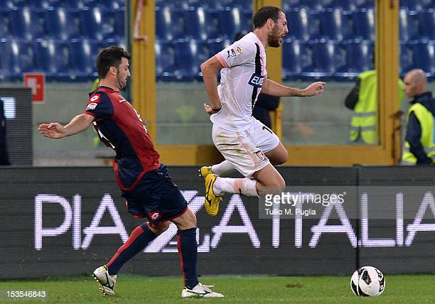 Luigi Giorgi of Palermo and Cesare Bovo of Genoa compete for the ball during the Serie A match between Genoa CFC and US Citta di Palermo at Stadio...