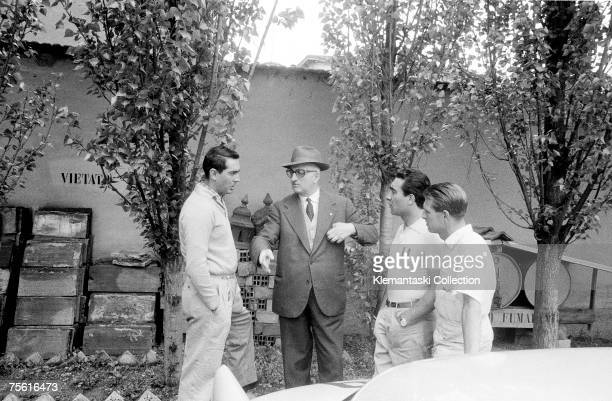 Luigi Musso Enzo Ferrari Eugenio Castellotti and Peter Collins discuss the upcoming Mille Miglia at Maranello April 1956