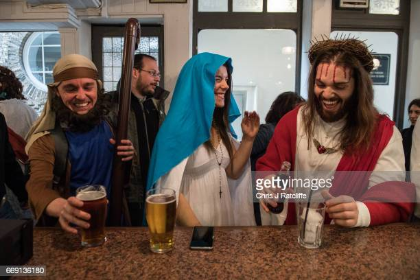 Luigi Pertrilli shares a joke with a woman dressed like the Virgin Mary in the Christopher Inn during the Christathon X pub crawl on April 16 2017 in...
