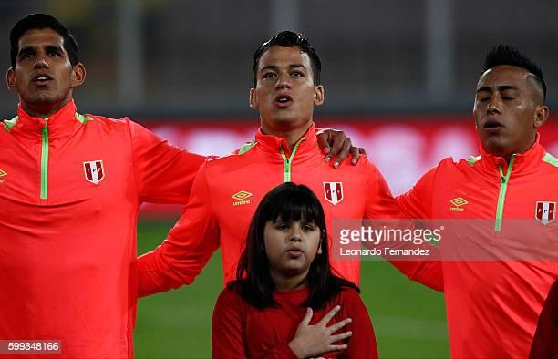 Luis Abram Cristian Benavente and Christian Cueva of Peru sing the national anthem prior to a match between Peru and Ecuador as part of FIFA 2018...