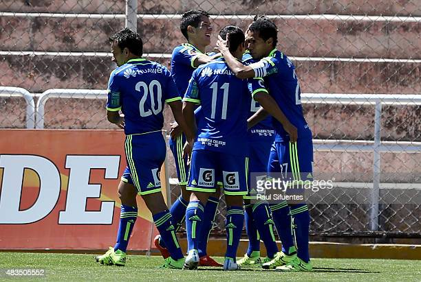Luis Abram of Sporting Cristal celebrates with his teammates after scoring the first goal of his team during a match between Real Garcilaso and...