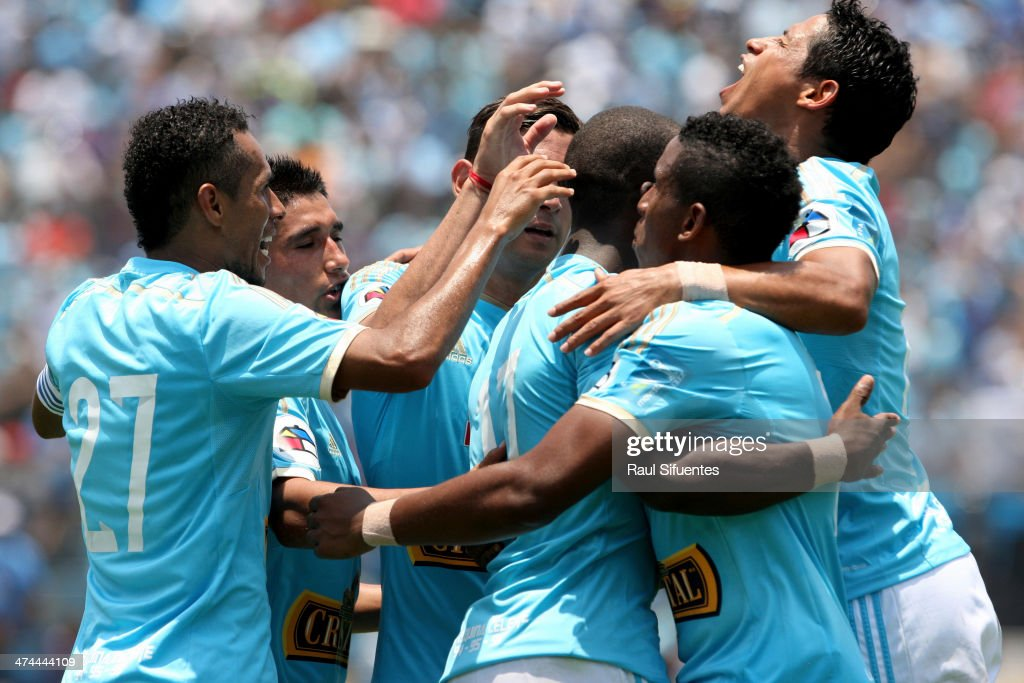Luis Advincula and his teammates of Sporting Cristal celebrate after scoring their team's third goal against Leon de Huanuco during a match between Sporting Cristal and Leon de Huanuco as part of second round of Copa Inca 2014 at Alberto Gallardo Stadium on February 23, 2014 in Lima, Peru.
