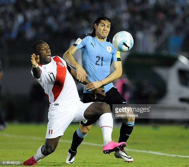 Luis Advincula of Peru and Edinson Cavani of Uruguay fight for the ball during a match between Uruguay and Peru as part of FIFA 2018 World Cup...