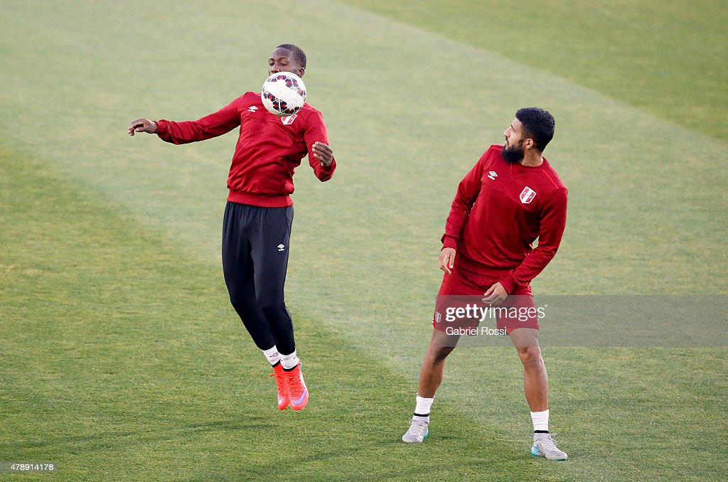 Luis Advincula of Peru controls the ball next to Josepmir Ballon of Peru during a field scouting prior to the semi final match against Chile at Nacional Stadium as part of 2015 Copa America Chile on June 28, 2015 in Santiago, Chile.