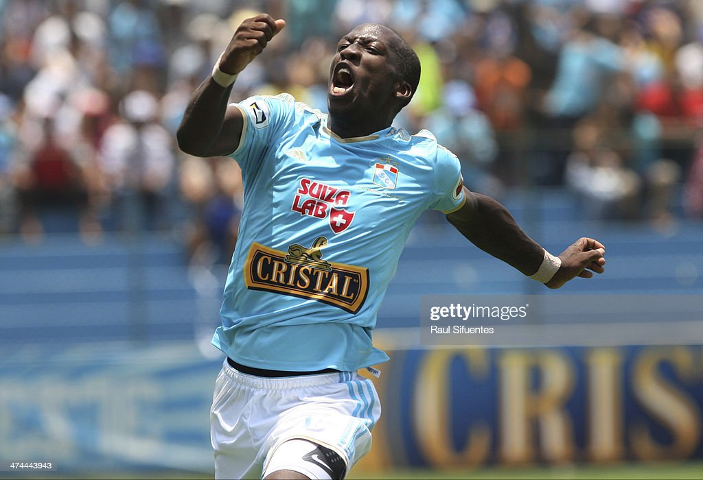 Luis Advincula of Sporting Cristal celebrates after scoring his team's third goal against Leon de Huanuco during a match between Sporting Cristal and Leon de Huanuco as part of second round of Copa Inca 2014 at Alberto Gallardo Stadium on February 23, 2014 in Lima, Peru.