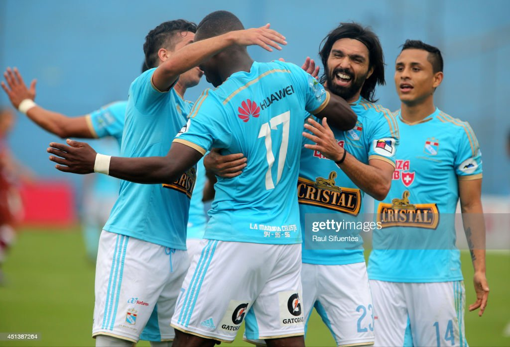 Luis Advincula of Sporting Cristal celebrates scoring the second goal of his team against Inti Gas during a match between Sporting Cristal and Inti Gas as part of fourth round of Torneo Apertura 2014 at Alberto Gallardo Stadium on June 28, 2014 in Lima, Peru.