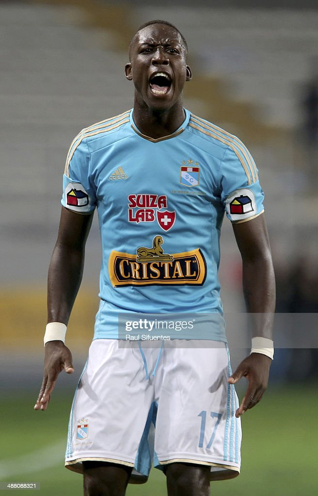 Luis Advincula of Sporting Cristal reacts during a match between Alianza Lima and Sporting Cristal as part of 12th round of Copa Inca 2014 at Nacional Stadium on May 03, 2014 in Lima, Peru.