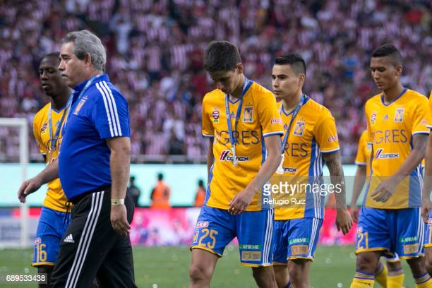 Luis Advíncula Jurgen Damm Lucas Zelarrayán and Francisco Meza of Tigres look dejected after losing the Final second leg match between Chivas and...