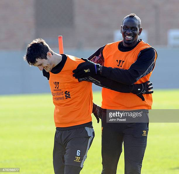 Luis Alberto and Mamadou Sakho of Liverpool during a training session at Melwood Training Ground on February 27 2014 in Liverpool England