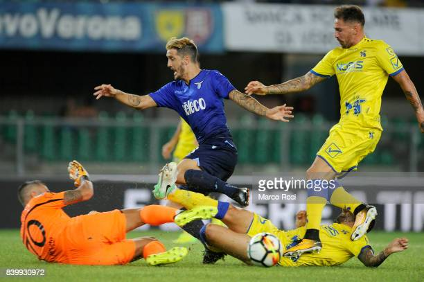 Luis Alberto compete for the ball with Alessandro Gamberini and Stefano Sorrentino of AC Chievo Verona during the Serie A match between AC Chievo...