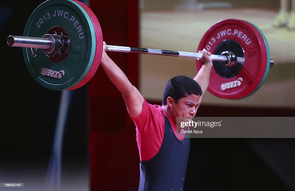 Luis Alberto Garcia Brito of Dominican Republic B competes in the Men's 56kg snatch during day one of the 2013 Junior Weightlifting World Championship at Maria Angola Convention Center on April 04, 2013 in Lima, Peru.