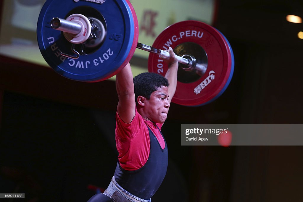 Luis Alberto Garcia Brito of Dominican Republic B competes in the Men's 56kg during day one of the 2013 Junior Weightlifting World Championship at Maria Angola Convention Center on April 04, 2013 in Lima, Peru.