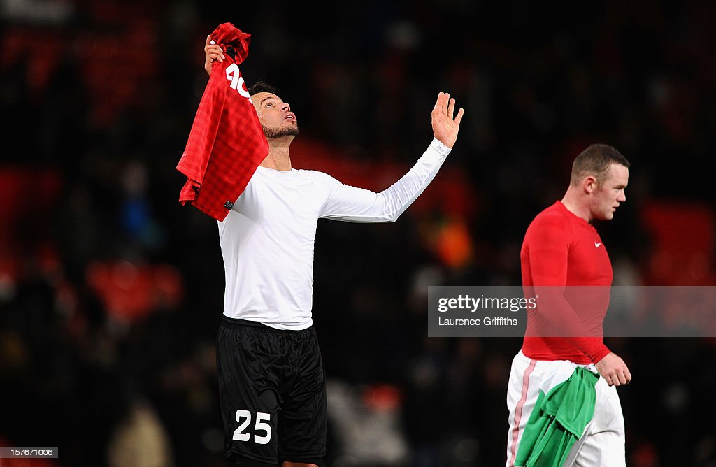 Luis Alberto of CFR 1907 Cluj celebrates at the end of the UEFA Champions League Group H match between Manchester United and CFR 1907 Cluj at Old Trafford on December 5, 2012 in Manchester, England.