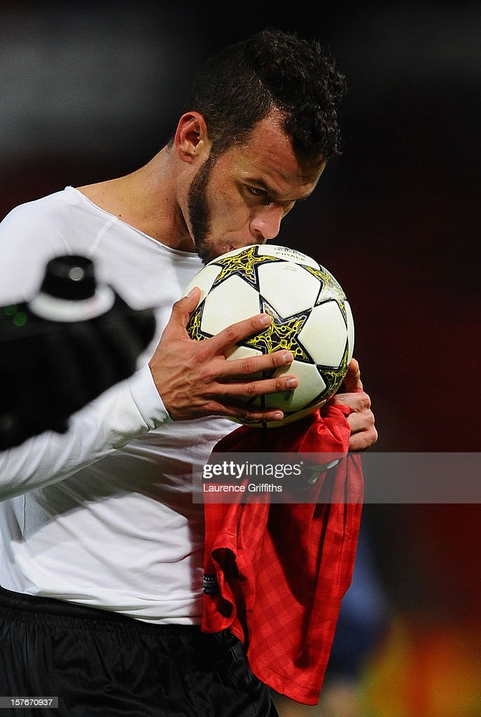 Luis Alberto of CFR 1907 Cluj kisses the match ball at the end of the UEFA Champions League Group H match between Manchester United and CFR 1907 Cluj at Old Trafford on December 5, 2012 in Manchester, England.