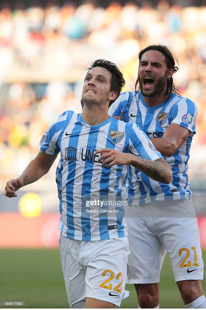 Luis Alberto of Malaga CF (L) celebrates with Sergio Sanchez after scoring against Athletic Club Bilbao at La Rosaleda Stadium on August 23, 2014 in Malaga, Spain.