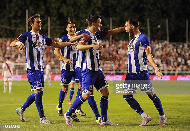 Luis Alberto of RC Deportivo la Coruna celebrates with Lucas Perez after scoring Deportivo's 2nd goal during the La Liga match between Rayo Vallecano...