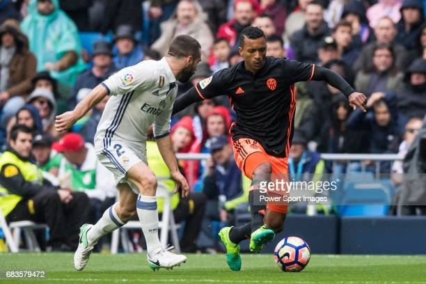 Luis Almeida da Cunha Nani of Valencia CF is challenged by Daniel Carvajal Ramos of Real Madrid during their La Liga match between Real Madrid and...