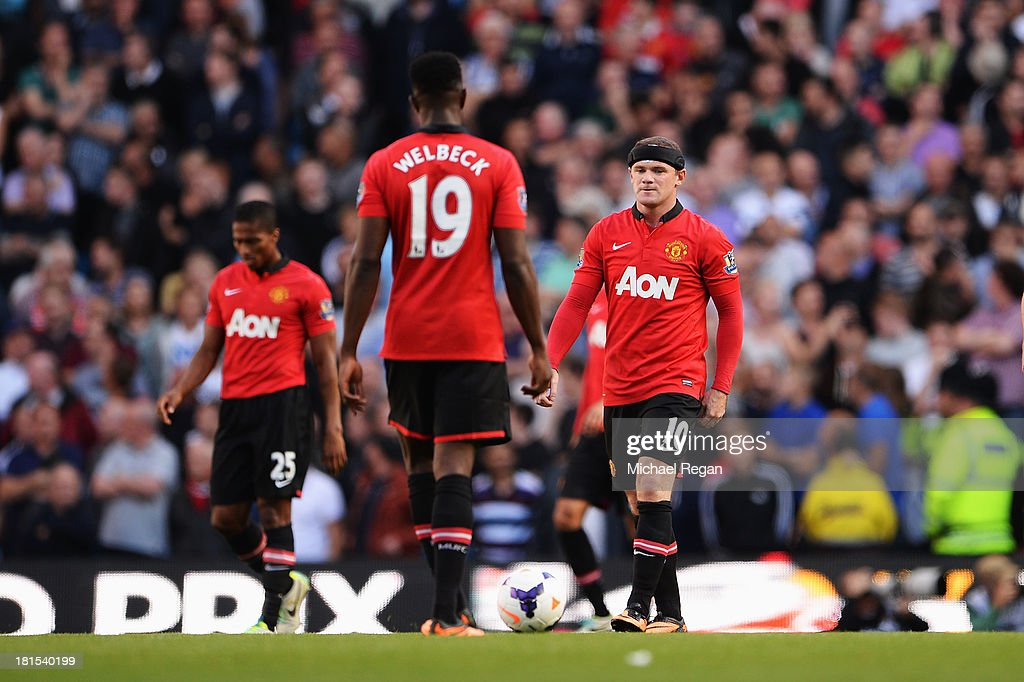 Luis Antonio Valencia, Danny Welbeck and Wayne Rooney of Manchester United look despondent during the Barclays Premier League match between Manchester City and Manchester United at the Etihad Stadium on September 22, 2013 in Manchester, England.